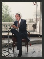 Senator Bob Dole being interviewed on balcony of U.S. Capitol, c. 1988