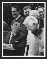 Senator Bob Dole enjoying a laugh with President Reagan, 1983