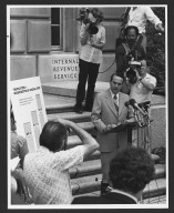 Senator Bob Dole, Senate Finance Committee addressing press, 1981