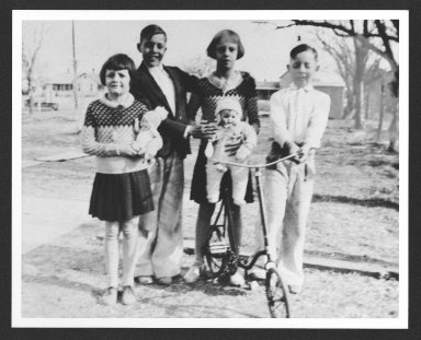 Bob Dole and siblings with bicycle, c. 1934