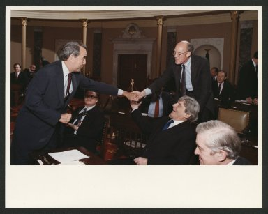 Newly-elected Senate Majority Leader, Senator Bob Dole receiving congratulations from colleagues, 1984