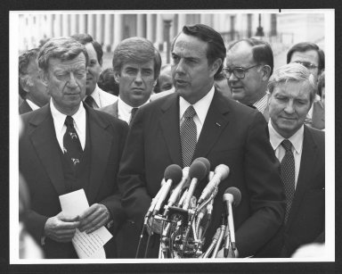 Senator Bob Dole holding a news conference with Joint Committee on taxation, 1982
