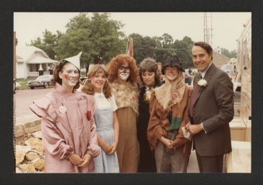 Senator Bob Dole conversing with Wizard of Oz characters, 1982