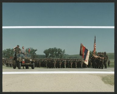 Senator Dole inspecting troops at Fort Riley, KS, 1985