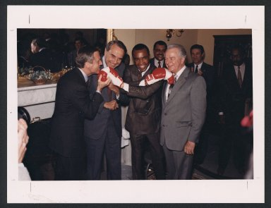 Senators Bob Dole and Robert Byrd meeting Sugar Ray Leonard, 1988