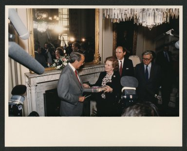 Senator Bob Dole presenting Margaret Thatcher with a gift