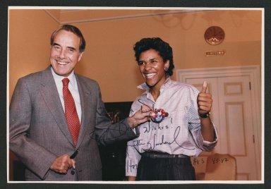 Senator Bob Dole presenting 1988 Campaign button to Lynette, 1987