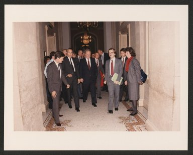 Senator Bob Dole walking with his Press Secretary Walt Riker, and Judge Robert Bork after Bork's U.S. Supreme Court of Appeals nomination hearings, 1987