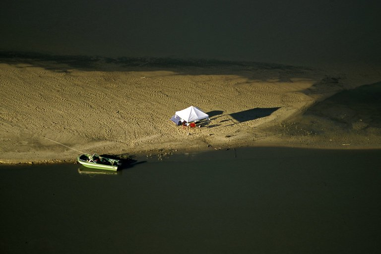 Tent and boat along Missouri River