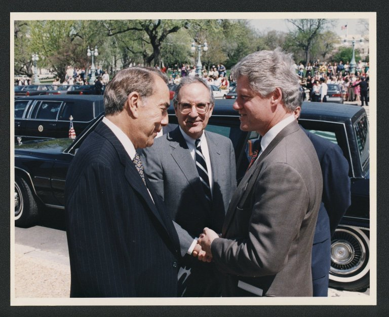 Senator Bob Dole and Bill Clinton conversing, 1994