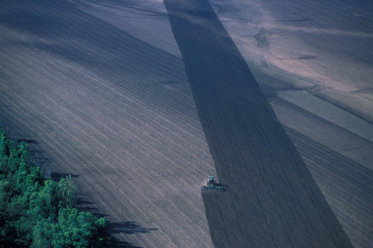 Tractor Furrowing/Plowing a field